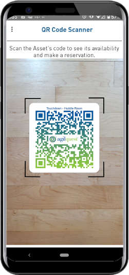 mobile phone showing QR Code scanner for claiming hot desk space